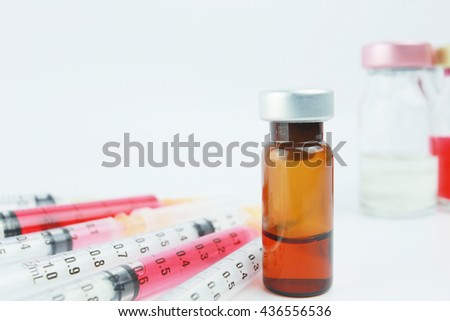Selective focus vial and syringes with blurred background in the hospital. : medication,vaccine, drugs, blood, laboratory. - stock photo