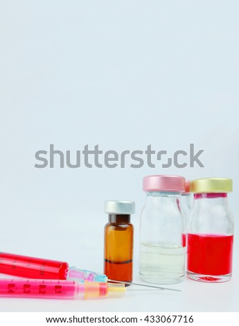 Selective focus vials and  syringes with blurred background  in the hospital. : medication,vaccine, drugs, blood, laboratory with Copy space. - stock photo