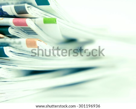 selective focus with extremely DOF of closeup stack of the newspaper  background , business information concept - stock photo