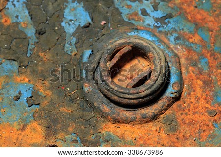 Selectively focused cap of an old rusty oil tank - stock photo
