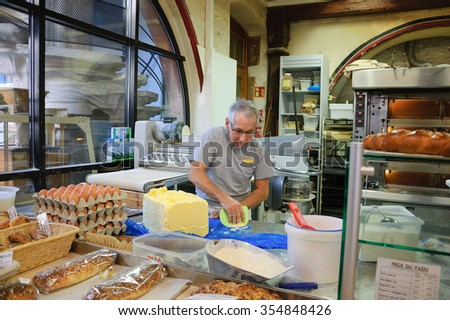 SELESTAT, FRANCE - DECEMBER 20, 2015: Bakers preparing dough for Christmas pastries at Bread house (La Maison du Pain). Selestat, located on Alsace wine route, is known as home of Christmas tree.