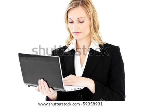 Self-assured businesswoman using her laptop standing against white background