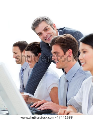 Self-assured manager working with his team against a white background