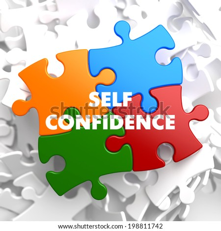 Self Confidence on Multicolor Puzzle on White Background. - stock photo