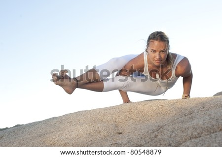 Self determined woman in the yoga posture Astavakrasana. - stock photo