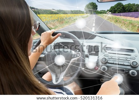 Self-driving car concept - woman driving modern car