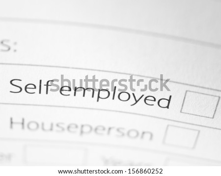 SELF EMPLOYED printed on a form close up