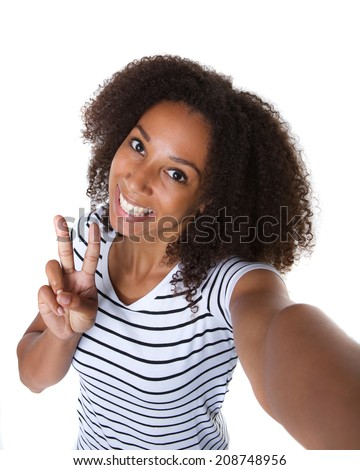 Self portrait of a happy young woman making selfie against isolated white background - stock photo