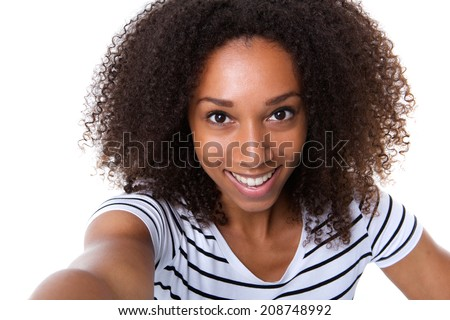 Self portrait of a young woman making a selfie against isolated white background  - stock photo