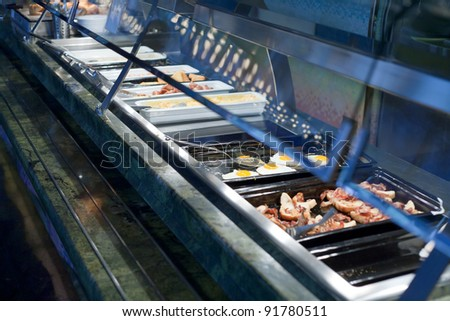self-service buffet with hot breakfast in hotel - stock photo