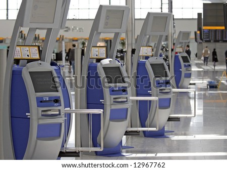 Self service check in stations at Terminal 5 Heathrow Airport - stock photo