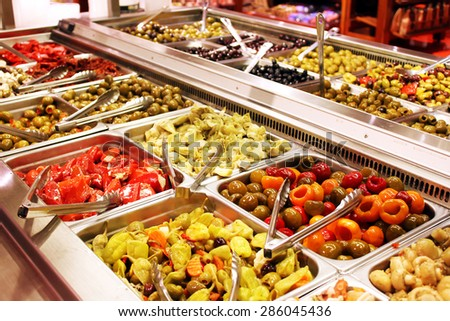Self service salad bar with a variety of salads and side dishes - stock photo