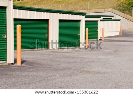 self storage mini warehouse units with room for text on the doors or on the pavement. - stock photo