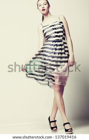 Selfhood. Funky Woman wearing Stylish light Fluttering Dress - stock photo