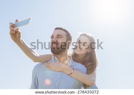 Selfie. A loving couple taking a photo at the park