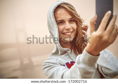 Selfie, Beautiful girl taken pictures of her self, instagram - stock photo