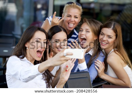 Selfie Five women sitting in a cafe on the street - stock photo