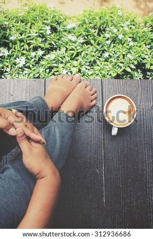 Selfie of coffee with feet in the garden