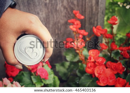Selfie of hand with cola can
