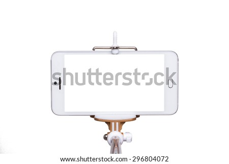 Selfie on smartphone using monopod - Isolated on white background - stock photo