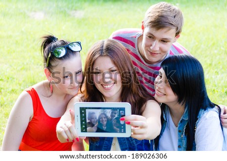 selfie or selfy portrait: group of four happy smiling young people ...