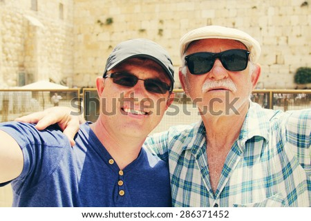 Selfie portrait of father and adult son near the Western Wall in Jerusalem