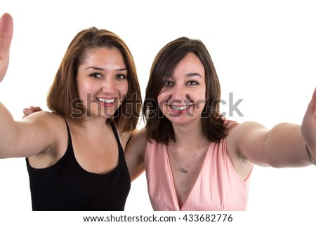 Selfie portrait of two young positive woman having fun as, friends