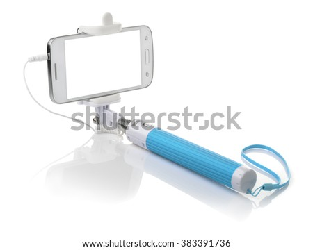 Selfie stick with smartphone isolated on white - stock photo