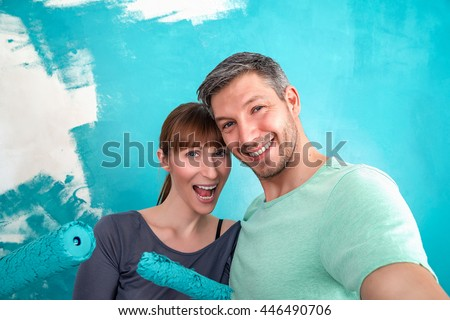 selfie while painting wall at home - stock photo