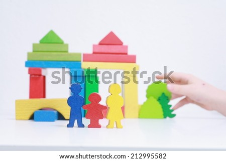 selfmade wooden figures symbolizing family life - metaphor - stock photo