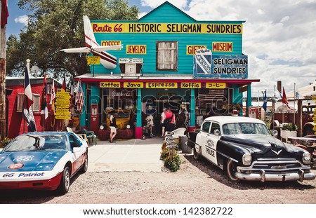 SELIGMAN - AUGUST 3: The Historic Seligman Sundries on August 3, 2012 in Seligman, Arizona. Built in 1904, today, the Seligman Sundries is Seligman�¢??s only gourmet coffee bar and gift shop. - stock photo