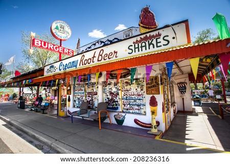 SELIGMAN, AZ - MAY 8, 2014:  Landmark Delgadillo's Snow Cap Drive-in eatery and roadside attraction located along   Route 66 in Seligman, Arizona. - stock photo