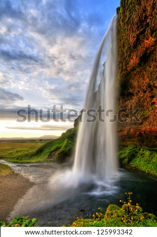 Seljalandfoss waterfall at sunset in HDR, Iceland - stock photo