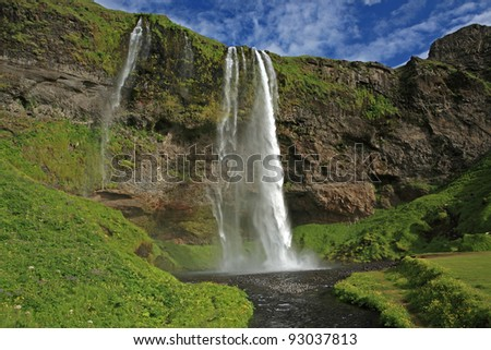 Seljalandsfoss waterfall in southern Iceland - stock photo