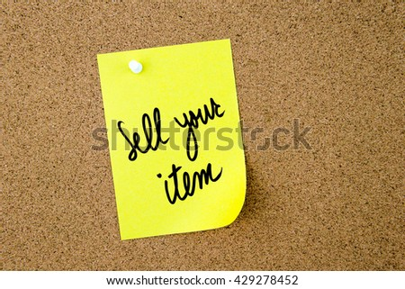 Sell Your Item written on yellow paper note pinned on cork board with white thumbtack, copy space available - stock photo