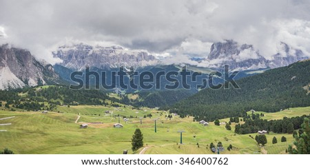 Sella and Sassolungo mountain groups as seen from Col Raiser, beautiful and large high alpine pastures of Val Gardena, above the villages of Ortisei and St. Christina, Dolomites, South Tyrol, Italy