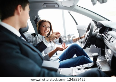 Seller and buyer at the wheel - stock photo