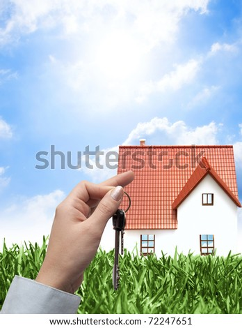 Selling house on a green field - stock photo