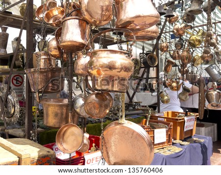 Selling old copper cookware. San Telmo market in Buenos Aires, Argentina.