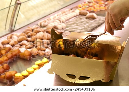 selling pastries, especially the filling of a tray  - stock photo