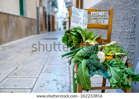 Selling vegetables in the streets of Mola di Bari, Puglia, Italy - stock photo