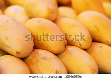 Selling yellow mango in Phuket market, Thailand - stock photo