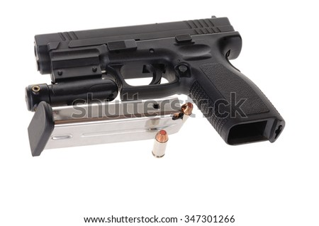 Semi-auto handgun equipped with a laser sight, and a magazine isolated on white - stock photo