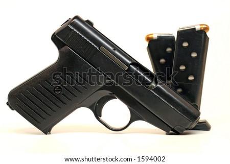Semi-Automatic Handgun and Magazines - stock photo