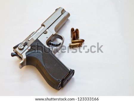 Semi-automatic pistol and bullets. pistol weapon for safety or dangerous - stock photo