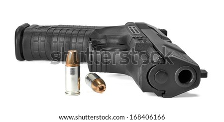 semi-automatic pistol lying on side with ammunition
