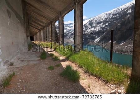 Semi indoor tracks along Arno man-made lake basin at 1900 meters on the sea-level. Italy - stock photo