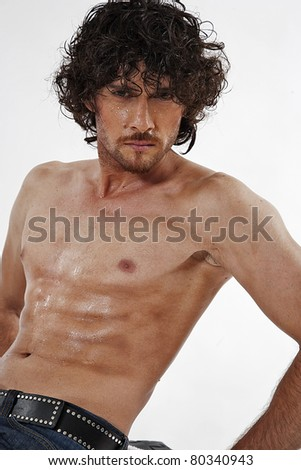 semi nude portraits of a handsome muscular man isolated on white in studio