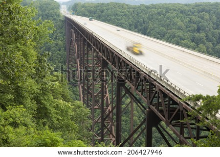 Semi Truck in Motion On New River Bridge - stock photo