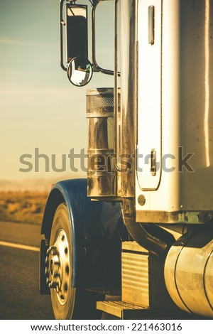 Semi Truck Tractor Closeup on the Highway in Vertical Photography. - stock photo